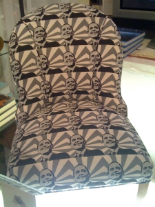 Chair upholstered in mod Obama fabric!