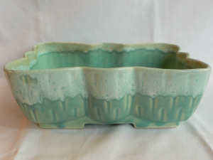 Ivory and green aqua glazed put. Cool shape!