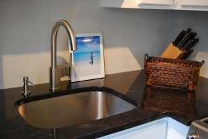 Brushed stainless steel single lever faucet and soap dispenser.