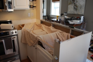 Countertop ripped out and wall about to be cut down.