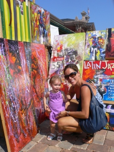 My niece and I enjoying the sunny day and bright paintings.