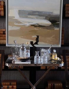 A simple and inviting bar. The artwork is divine!