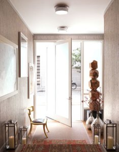 The entrance. I love the Phillip Jeffries grass wallpaper for texture and lux.