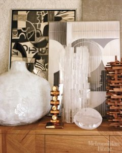 Kelly loves her vignettes; a Robert Kuo crystal accents abstract art paintings