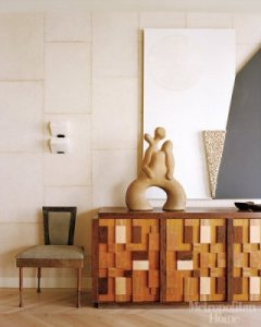 Wearstler designed this sideboard; alabaster wall sconce; vintage side chairs
