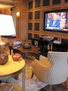 Leather panels and nailhead give oomph to the TV wall. Love the cabinet!