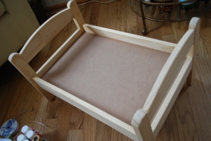 I started with a kids doll bed from Ikea.