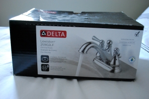 Delta polished nickel faucet.