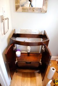 Wood vanity in place waiting for the new sink!