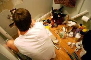 handyman fixing the plumbing