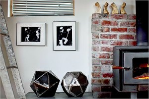 A pair of artful metallic objects that she welded in an industrial tent in her driveway.