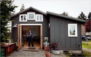 Michele de la Vega outside her small garage home.