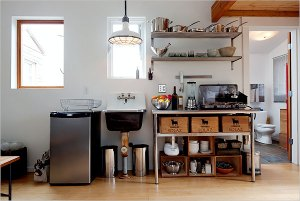 industrial sink, ceiling lamp and wooden wine crates are all salvaged items