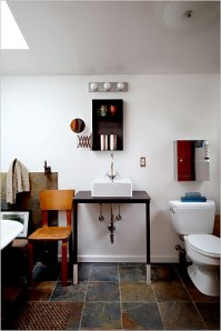 She herself designed and welded the red metal locker and recessed metal shelf above the sink.