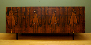 Brazilian 1970's rosewood credenza with solid copper drawer handles.