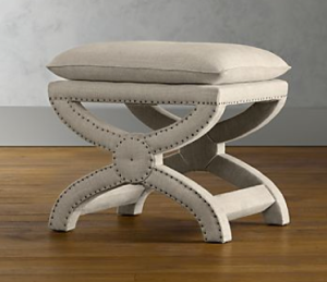 Belgian linen cloaked X-base Toscane Stool outlined in hammered brads. | RH.com