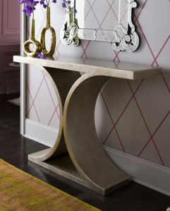 The silver lacquer finish and nickel accents of this hardwood Console table brings pizazz and motion to a hallway. | Neiman Marcus