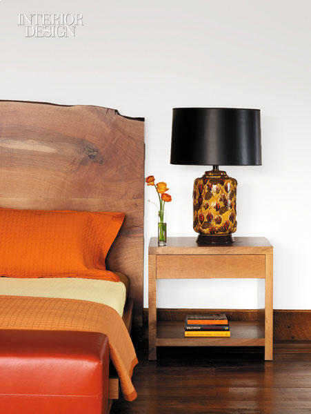 A simple vintage lamp sits beautifully on a French walnut table in the master bedroom.