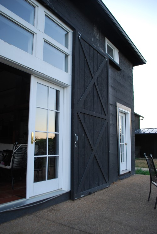 Barn doors open up to views outside and across the patio.