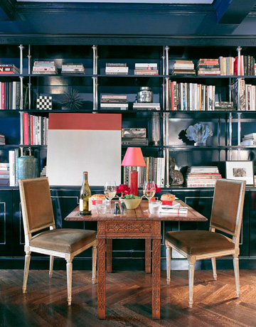 Eclectic and deeply lacquered library designed by Miles Redd.