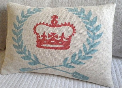 Embrace your nautical side with this cream cotton twill linen bolster emblazoned with a duck blue egg wreath and red crown., $44