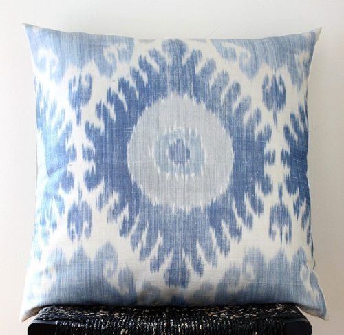 "This large blue ikat silk pillow cover is the star of the show at 22"" square., $60"