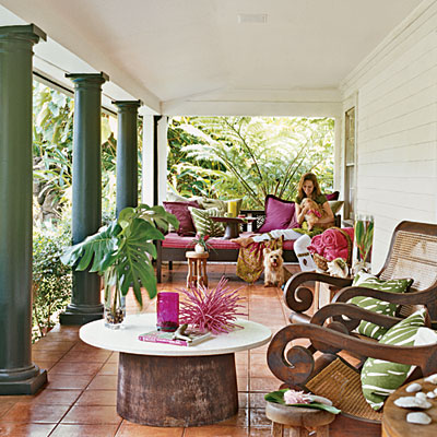 The pinks and greens are upbeat and the furnishings add decorative details to a partially open outdoor space.