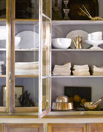 OPen kitchen cabinets are so pretty - but keep the possessions neatly displayed!