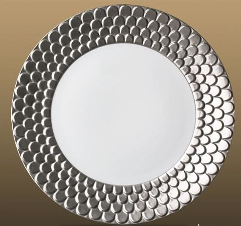 The Aegean Platinum handmade dinnerware by l'Objet is more cool metal and ringed in one of my favorite pattern of scales.