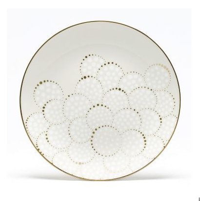 "A linear pattern of gold dots radiates out of a center like rays of light when you sit down to Barbara Barry's Wedgewood ""Radiance"" collection."