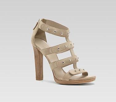 Sigourney' high heel platform sandal with metal stud detail.