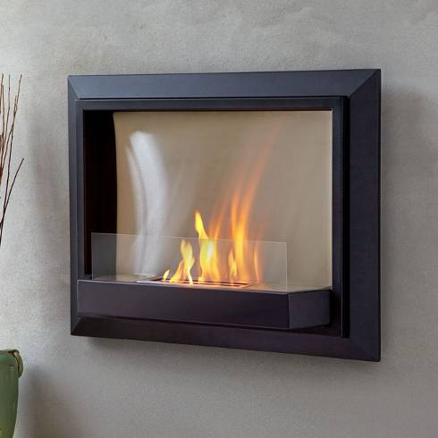 The Envision wall-hung fireplace is framed with black steel and fronted with a glass edge. Works in many different interiors.