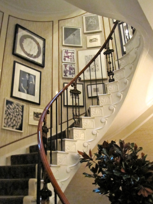 Artful staircase with awesome wallpaper insets by Rod Winterrowd.
