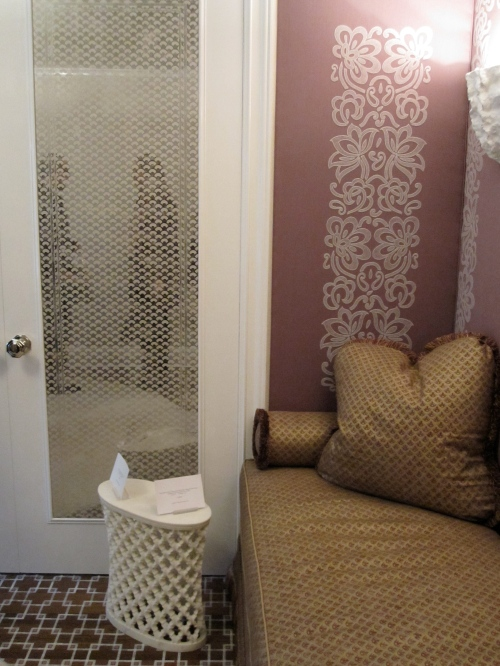 In the womens lounge room, the wall closets were mirrored and then painted with a subtle and tiny pattern in a chalky color paint. Delicate and gorgeous.