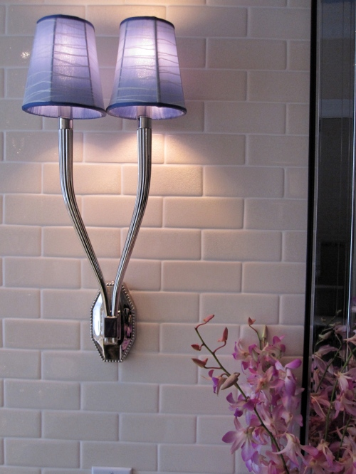 The lilac sconce shades were a welcome touch to nickel fixtures and worked with the slate blue of the area rug.