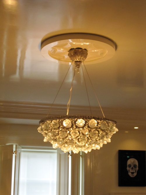 I WANT this fantastic rock cryestl like hanging dome ceiling light - don't you love how the light reflects off the glossy ceiling?