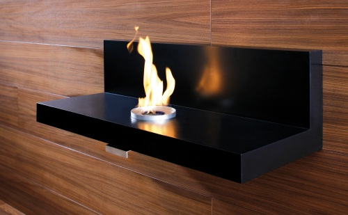 The LoungeFire is a fireplace dressed as an elegant piece of furniture.