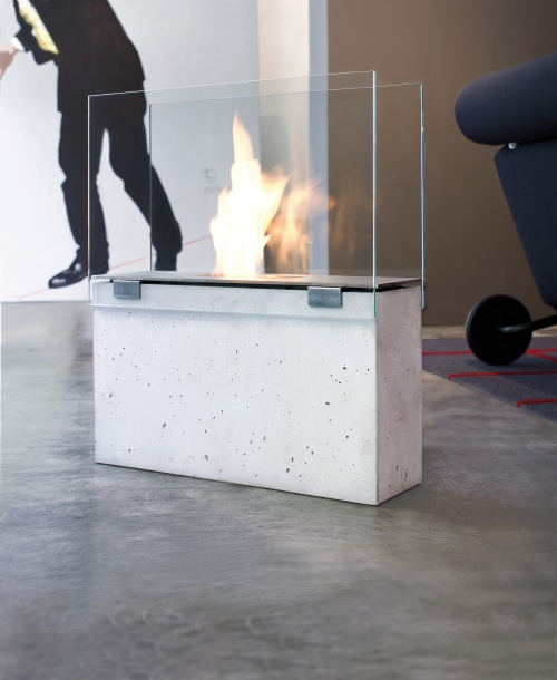 Cast from glass fibre reinforced concrete and combined with stainless steel and glass, the MURO is the minimalist fireplace.