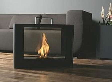 The TravelMate Mobile fireplace is a portable gas fireplace built into a suitcase-sized steel-and-glass enclosure.