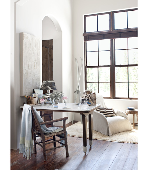 White washed and salvaged, some of the interior furnishings, like this desk, were picked up from areas like Yellowstone. Now that's lived in!