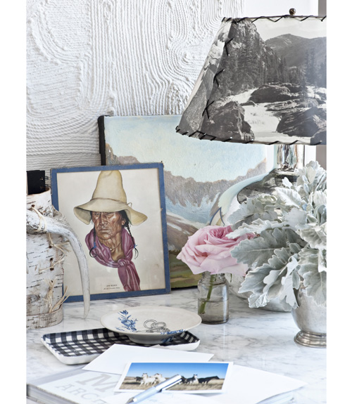 I love this table scape of a photo transfer screen lamp shade, oil-paintings, against a backdrop of faux bois like wall plaster.