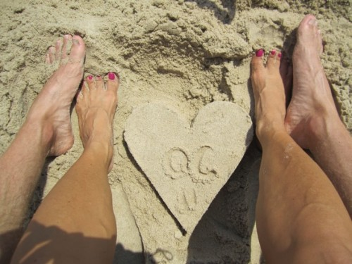 feet in ocean city sand heart by greg