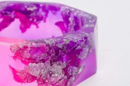 Pink and Purple resin bangle made with eco resin containing silver flakes with large triangle facets
