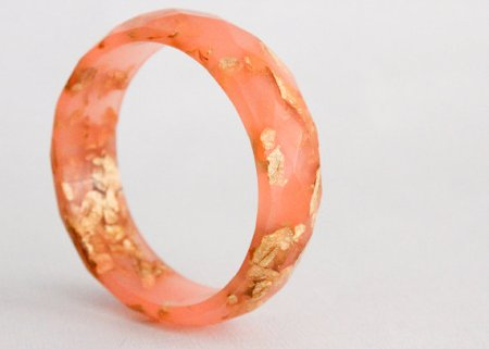 Strawberry pink multifaceted eco resin bangle with metallic gold flakes.