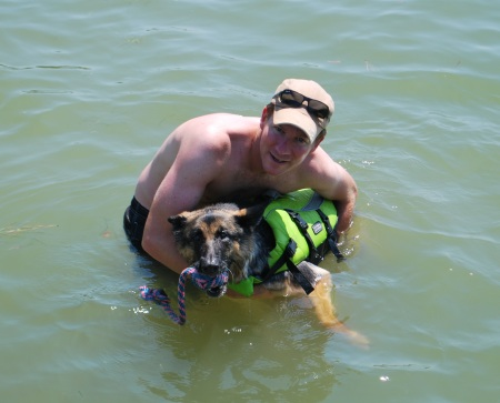 Hubby and Alpha going for a swim... old girl needed a life vest to keep her head up.