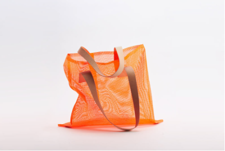orange mesh air tote bag with leather strap